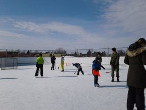 A photo of community members using the outdoor rink