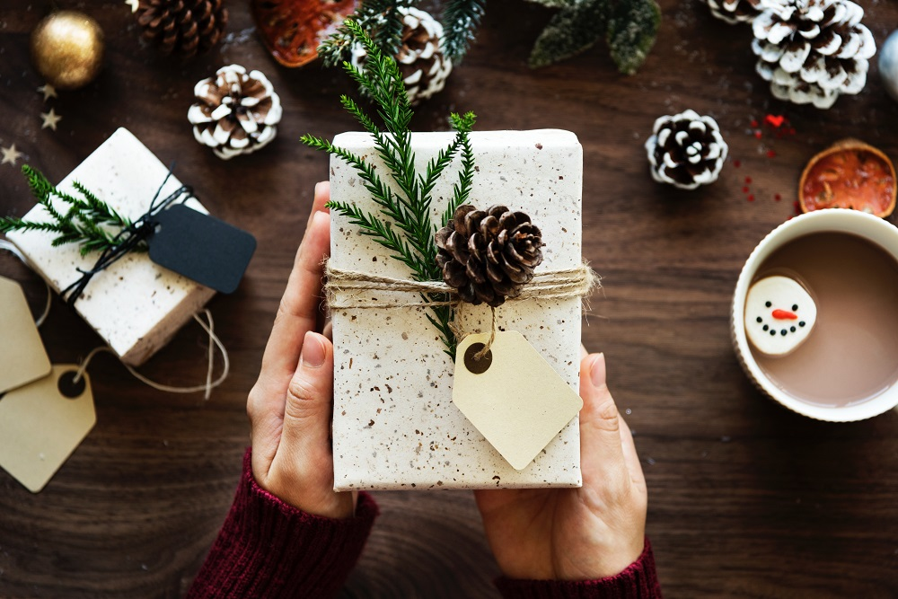 image of hands holding a gift
