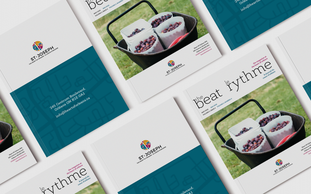 Photo showing several copies of The Beat le rhythme newsletter from the Heart of Orleans BIA