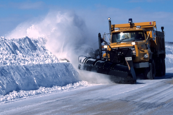 image of a snowplow pushing snow