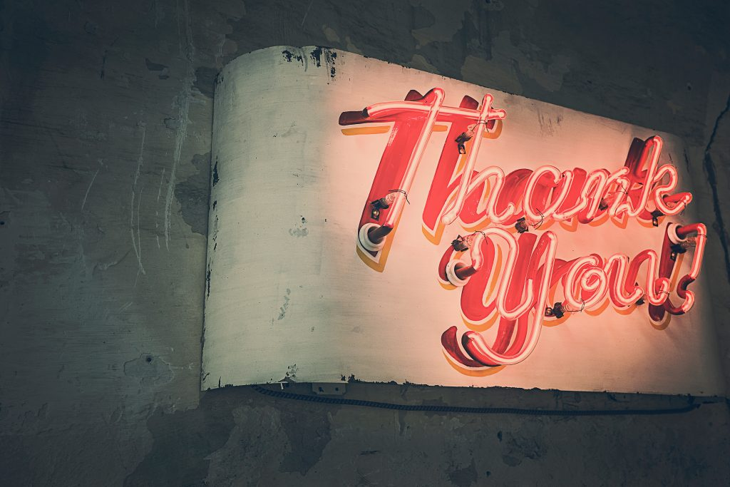 neon sign saying thank you