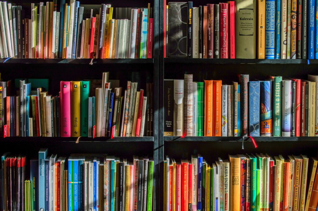 image of colourful books on bookshelves