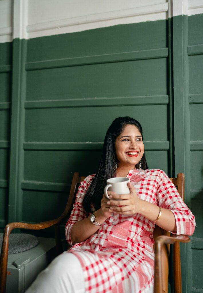 woman holding a tea and smiling