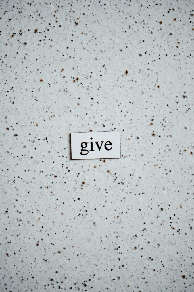 """the word """"give"""" on a white speckled background"""