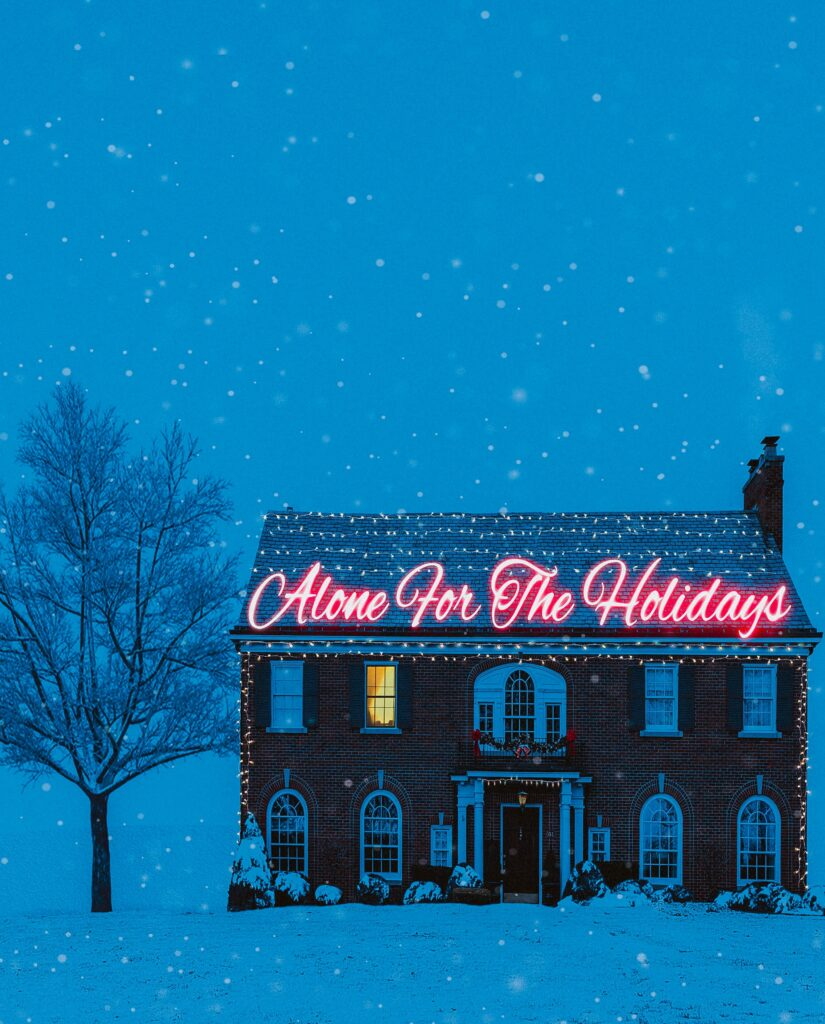 """image of a house decorated in holiday lights and a lit up sign saying """"alone for the holidays"""""""