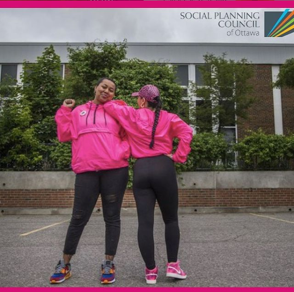 picture of Hit the Streets founders in bright pink jackets.
