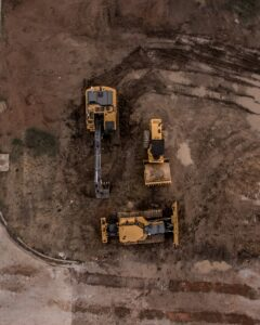 aerial image of construction vehicles on a dirt surface